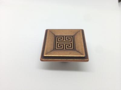 "Ручка-кнопка ""Ника"", отделка бронза античная красная 25.622.C000.23"